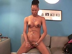 TS Foxy Fun plays with oil on her cock