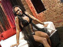 Ebony TS Kayla strokes her huge cock