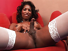 Black tgirl in white peeing in a bowl