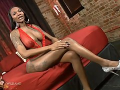 Sexy ebony TS Elyktrah strips and plays