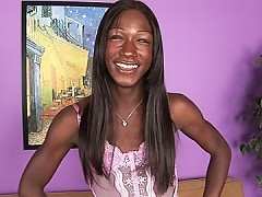 Chocolate tranny yanks a load onto her chest