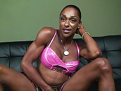 Hard bodied ebony tranny slowly stroking her big dick