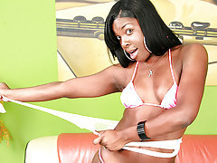 Black shemale Tiffany works her ass with a big dildo