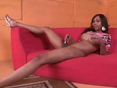 Stunning ebony tranny posing nude on red sofa