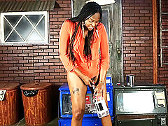 Black hottie Nia pees and plays